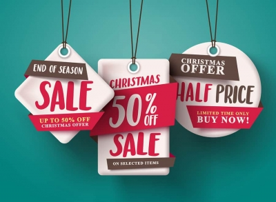 End of season Christmas sale tags hanging with half price text and with origami paper style for holiday discount promotion.