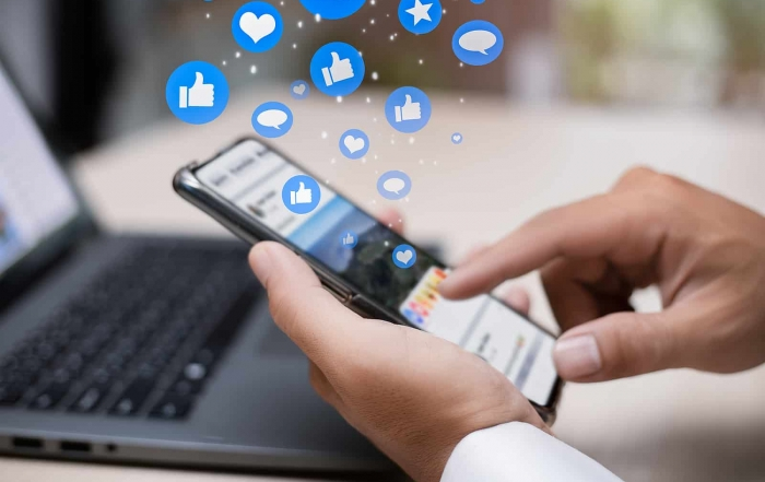 Man person hands holding smartphone for social interaction on social media with notification icons like, heart, comment message and star, digital marketing and social media concept.