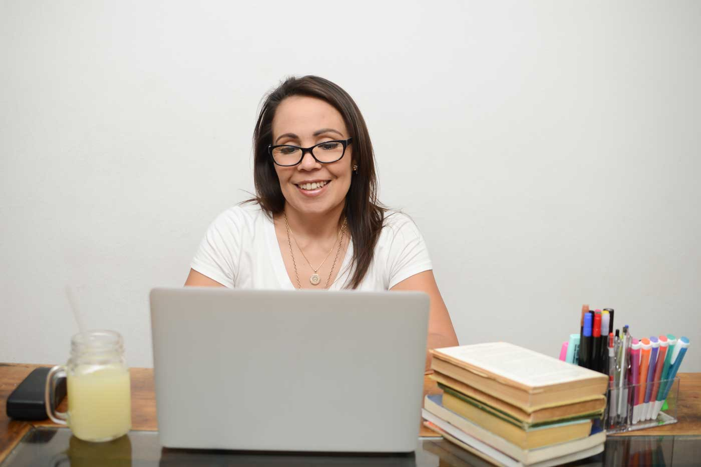 Woman creating a marketing email on her laptop.