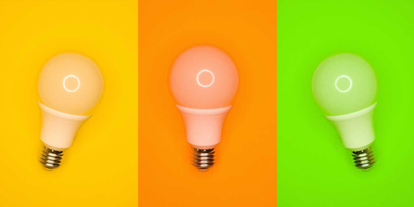 three light bulbs on colored backgrounds